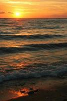 zonsondergang / zonsopgang op het strand